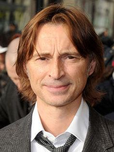 Robert Carlyle. in Dublin, while waiting for U2's nightclub to open, I was talking to the bouncer for the place across the street, and RC approached him to ask for directions. he's very nice.