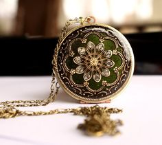 Mothers Day Jewelry / Wedding Locket / Olive Green / Round Brass Upcycled Vintage Locket / Bridal Jewelry / Spring Wedding / Mourning Locket. $84.50, via Etsy.