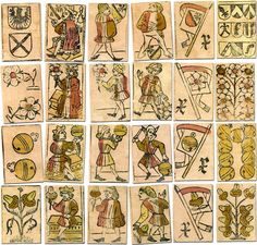 """Swiss playing cards, c. 1530. The Swiss national suit system of shields, acorns, hawkbells and flowers originated sometime during the fifteenth century. The playing cards shown here were made in Basel, c.1530. They were discovered inside a book cover and reproduced in 1998 to celebrate the 20th anniversary of Cartophilia Helvetica. A distinguishing feature is the """"banner 10"""" cards, which are now more or less counted as an ace. The kings are seated."""