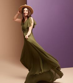 This long olive green chiffon bridesmaid dress gives an aura of dreamy romance from the softly pleated, plunging-V neckline to the billowy, floating full circle skirt. The faux-wrap style bodice is finished with soft, flattering flutter sleeves. Pair with a brown brimmed hat for a boho bridesmaid look! | #greenbridesmaiddress #bohobridesmaids | Style F20065 in Martini Olive | Shop this style and more at davidsbridal.com Olive Green Bridesmaid Dresses, Maternity Bridesmaid Dresses, Wedding Dresses, One Shoulder Bridesmaid, Full Circle Skirts, Chiffon Gown, Bridal Lace, Davids Bridal, Bodice
