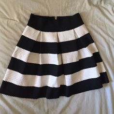 Striped Skirt Structured black and white striped skirt with exposed zipper in back. Very slimming. The waist has stretch. Barely worn, in perfect condition. Bought from a boutique. Honey Punch Skirts Circle & Skater