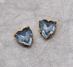14x11.5 Light Sapphire Blue vintage Heart shaped glass rhinestones - prong set in brass with one ring - 2pc. $4.00, via Etsy.