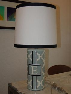 Handsome hand painted monogram lamp...headed to a CEOs office. I'd love a pair as bedside table lamps.