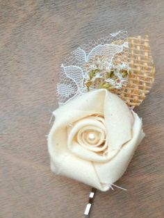 Rustic Cream Fabric Rosette - Wedding Hair Accessory - Natural Burlap Leaf, Ivory Lace Leaf, Soft White Wildflowers - Bobby Pin, Hair Clip. $12.50, via Etsy.
