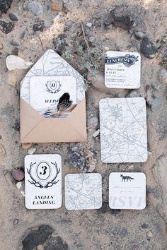 map inspired wedding invitations - photo by Tyler Rye Photography http://ruffledblog.com/rugged-desert-wedding-inspiration #weddinginvitations