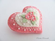 Hi! Perfect for Valentines Day or for anyone like me who just adores hearts, this all wool felt pin is decorated with hand embroidery, and teeny faux pearls, and crystals. Romantically lacy looking and very girlie! It measures just about 2 1/2 across by 2 1/8 top to bottom. Like all of my things, its my own design and carefully hand stitched. :D This is a clean, smoke free home. I ship my things within two days of your payment, except for items purchased on a Friday, those go out the…