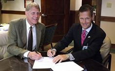 Southern Wesleyan University President Todd Voss, left, and Baptist Easley CEO Michael L. Batchelor sign a memorandum of understanding signaling collaboration on initiatives that include a new MBA healthcare administration concentration and wellness and prevention programs. http://www.swu.edu/about-swu/news/swu-baptist-easley-hospital-sign-agreement/#.U6L7xZRdWSo
