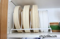 Kitchen organizing tips - I like the way she uses the wire rack for organizing paper plates & has baskets to throw all the tiny-little-cluttery rubber containers and lids.