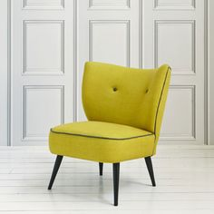 A delightfully comfortable linen occasional chair with contrasting buttons and piping.