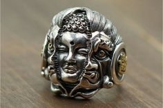 Intricately handcrafted with stunning details, this Buddha Devil Sterling Silver Ring is truly Wowsome. The Majestic Buddha Breaking through the face of the Devil King, Devil's furious eyes, Buddha's