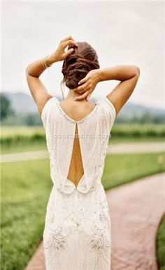 What an elegant back this vintage style wedding dress has... Loving the bead and crystal detail too.