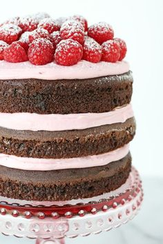 This Chocolate Raspberry Cake is beautiful, delicious… and amazingly easy to put together! Delicious raspberry frosting and fresh raspberries add to the beauty of this simple, yet impressive cake.