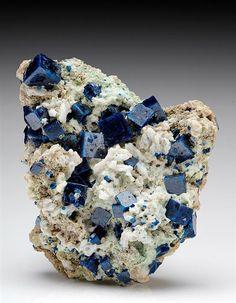 Classic deep blue cubic crystals of Boleite from the Amelia Mine, Baja California, Mexico.