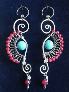Red Coral and Turquoise Seahorse Earrings by Crafitti. I think I would make some small earrings just using the little red faceted bead dangle at the bottom of these earrings.