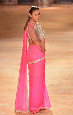 Ileana D'Cruz dressed in a neon-pink saree teamed with silver-toned blouse at the India Couture Week 2014 finale. Bollywood Celebrities, Bollywood Fashion, Bollywood Actress, Indian Bollywood, Indian Celebrities, Pakistani, Indian Dresses, Indian Outfits, Indian Attire