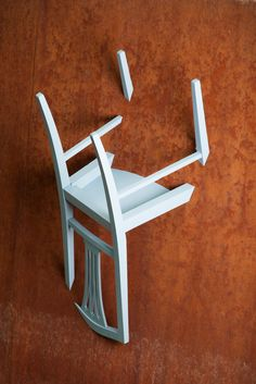A series of clothes hangers created by chairs. The pieces are cut and suspended upside down on a wall, in a way which gives the impression that they are sinking in it. The legs are heading upwards allowing us to hang clothes a.o, while the seat creates a place to leave personal objects (keys, wallet, etc).  The fact that the construction is made of used chairs, means that there is only a slight possibility to create the same model twice. Thing that makes every one of them unique. Used Chairs, Clothes Hangers, Wishbone Chair, Keys, Objects, Construction, Wallet, Create, Unique