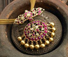 http://clothingandjewellery.blogspot.in/2012/08/elegant-temple-ruby-jewellery-from.html
