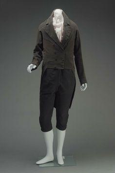 Man's Black Broadcloth Suit: Coat & Knee Breeches, American, 1810-1820. - Young Scrooge Apprentice Suit, also Dick Wilkins suit.