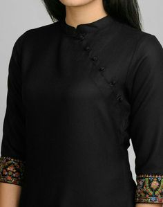 Featuring beautiful Kashmiri embroidery, this kurta with a contemporary twist is perfect this season. Wool Kashmiri Embroidery Chinese Collar Sleeves Dry Clean OnlyTop 50 Stylish And Trendy Kurti Neck Designs That Will Make You Look All The More Grac Neck Designs For Suits, Neckline Designs, Dress Neck Designs, Designs For Dresses, Blouse Designs, Kurthas Designs, Plain Kurti Designs, Salwar Designs, Kurta Designs Women