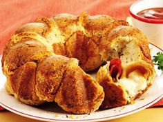 Kid-pleasing and easy pull-apart pizza made with refrigerated biscuits, pepperoni and cheese in a bundt pan. Serve warm pizza sauce on the side for dipping.