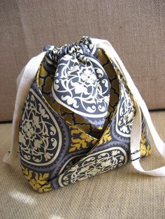 Fast and easy to make, cleverly folded drawstring bag.
