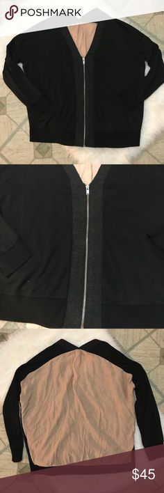 "zara • colorblock mixed media bomber jacket Super cute zip up v-neck cardigan! From the wool collection. Like new condition. Oversized fit. Black sweater with beige ""parachute"" back insert. Grey trim around the neckline and the zipper. UA to UA 25"", length 25"". Reasonable offers only, as I am hesitant to sell this beauty. Zara Sweaters Cardigans"