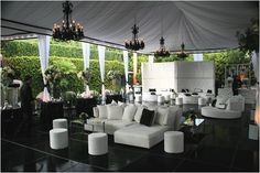 The lounge set up is much more attractive and functional than the typical reception set up of cocktail tables and sit down tables.