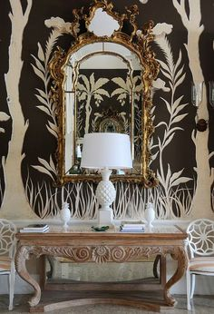Lyford Cay - Opulence at its best - white & black wallpaper, gilded gold mirror, and a white pineapple lamp Decor, Interior, Brown Walls, Lyford, Wallpaper, Mural, White Decor, Chinoiserie, Black And White Decor