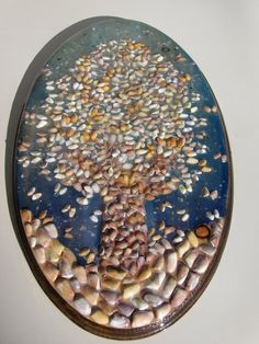 """""""Tree of Life"""" handmade with butterfly shells ( also known as coquina (Donax variabilis)) from Venice beach. Watercolor paint, glazed with resin. It measures 20""""x12"""", comes installed with a wall mounting hook. Infused with friendship, love and inspiration, perfect for the home, family and children. Handmade by Irina Dragomir-Thomason of www.artofirina.com and Dyanna Annai Beckwith of www.karmahigh.com $300"""
