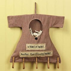 """Clothespin Bag - A Tisket A Tasket by TV. $16.99. Measures 10-1/2"""" x 13-1/2"""".. Clothespin Storage Bag. Embroidered Dress with """"A Tisket A Tasket Another Overflowing Basket"""". Cute Vintage Primitive Style.. Clothespin Bag. Decorate your laundry room with this whimsical clothespin storage bag. Designed to look like a dress that's just been hung out to dry it carries an uplifting rhyme to such a dutiful chore, """"A tisket, A tasket, Another overflowing basket."""" and includes five..."""