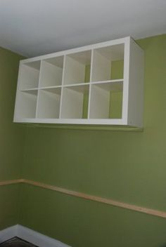 How to wall mount Expedit. Storage for school supplies. This way the kids can't get into it on their own and create chaos!