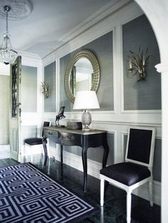 Despite low ceilings - look what can be done with millwork and grasscloth wallpaper.