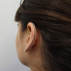"""""""Healed handpoked ear tattoo after one month."""