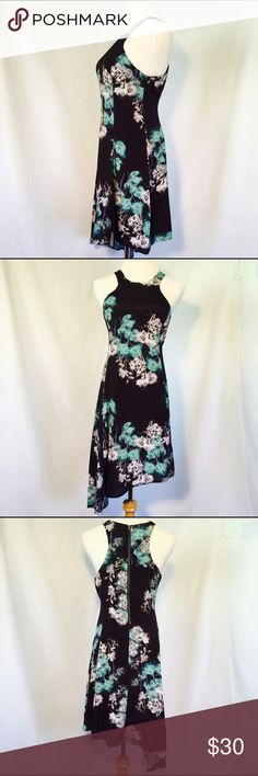 Women's Sleeveless Asymmetrical Floral Print Dress Women's Sleeveless Asymmetrical Floral Print Dress.  Zips up in the back. Material- Shell: 100% polyester. Lining: 100% polyester. Feel free to ask any questions! Dresses Asymmetrical