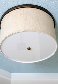 Isabelle LaRue of Engineer Your Space shows how to create a quick (and inexpensive) drum shade to upgrade ceiling light fixtures that look like they're stuck in the '80s.