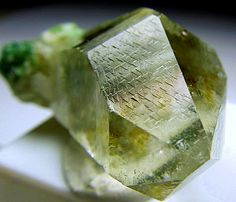 "A terminated Quartz crystal with little triangles on all the termination faces, which is pretty rare to find. In the metaphysical world, these are called ""record keepers"". There are Chlorite inclusions inside and some Fuchsite clusters at the base. It is very lustrous and gemmy. From Brazil."