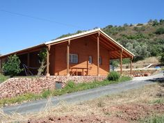 2 Bedroom Log cabin in Sao Bartolomeu de Messines to rent from pw. With balcony/terrace. Terrace, Shed, Outdoor Structures, Cabin, House Styles, Balcony, Outdoor Decor, Bedroom, Summer