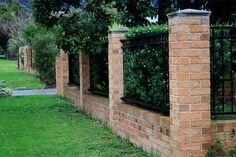 Brick fence  by Robert Wojciechowski, via Flickr