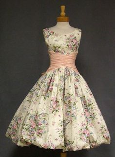 ~Fabulous 1950s cocktail dress in floral printed cream taffeta. This is the same dress (except with a pink waistband) as the Betty Draper Barbie doll dress!~