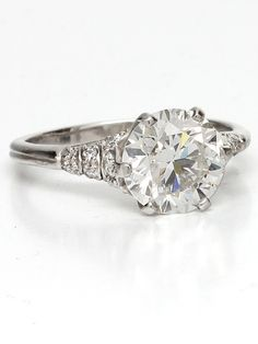 Edwardian Style Platinum and Round Cut Diamond Engagement Ring | From a unique collection of vintage engagement rings at https://www.1stdibs.com/jewelry/rings/engagement-rings/