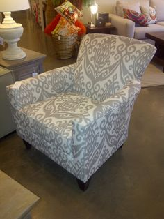 #urban_barn #spiedstyle adds dimension to the classic accent chair with a flared back