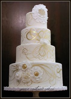 Gold and white wedding cake.