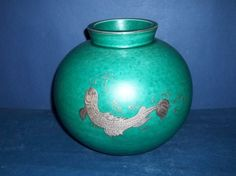 VASE IN ARGENTA DESIGNED BY WILHELM KAGE (1889-1960) FOR GUSTAVSBERG. Matte green glaze with sterling silver inlay.
