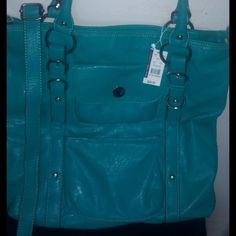 NWT NY&Co Teal Tote W/shoulder strap NWT NY&Co. Faux leather Teal Colored Tote bag with shoulder strap. Great for work or going out! Many pockets gear for any occasion. Bags Totes
