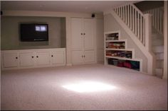 Like both storage under stairs and also built ins for media and storage