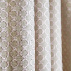 A beautiful, embroidered fabric in blush pink on a natural fabric with metallic gold detailing. Suitable for drapery, upholstery, cushions, pillows and other home decor accessories.