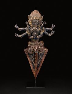 Tibet    Ritual Dagger: Vajrakila in Yab-yum, 16th century    Copper repoussé over wood
