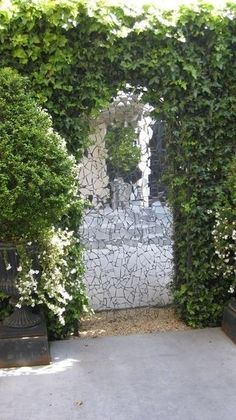 A mirror mosaic for the fence area. A terrific way of creating a sense of additional space.