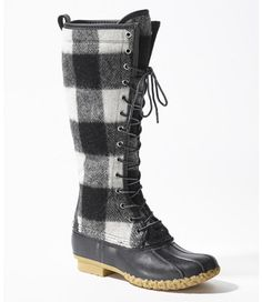 A bold new look for the original L.L.Bean icon: outfitted with a weather-resistant wool upper, patterned in a black-and-white buffalo check from the archives of Woolrich Woolen Mills. Sewn right here in Maine by our team of skilled stitchers, this boot preserves the rich heritage and quality craftsmanship we've prided ourselves on since 1912. Designed for comfort with a supportive steel shank and original rubber chain-tread bottom. Finished with a premium leather trim.