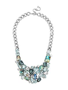 A luxe, clustered crystal bib interspersed with iridescent abalone accents is a mermaid princess-worthy statement.